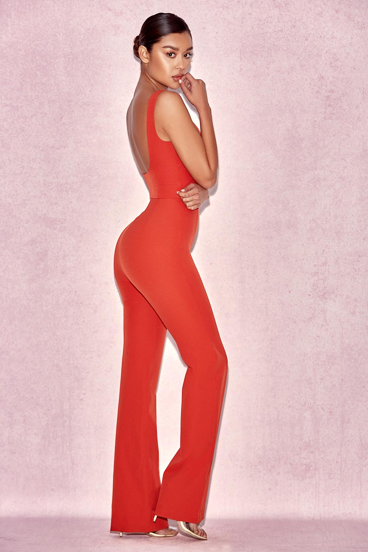 51b94adf27 Natalja Red V Plunge Jumpsuit. View larger image. View larger image. View  larger image. View larger image