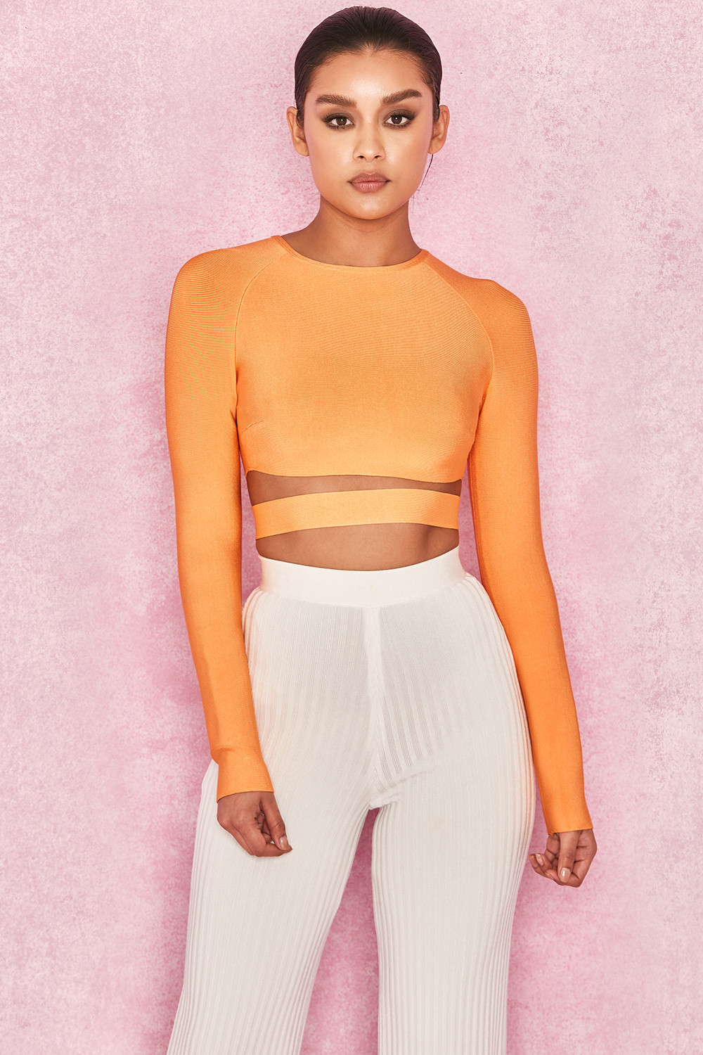 fec78c3f46682 Talika Neon Orange Bandage Crop Top with Waistband. View larger image. View  larger image. View larger image. View larger image. View larger image